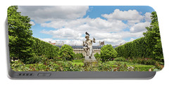 Portable Battery Charger featuring the photograph At The Palais Royal Gardens by Melanie Alexandra Price