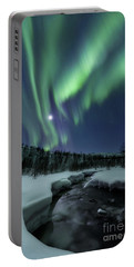 Portable Battery Charger featuring the photograph Aurora Borealis Over Blafjellelva River by Arild Heitmann