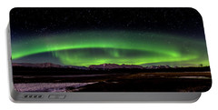 Portable Battery Charger featuring the photograph Aurora Spiral by Bryan Carter