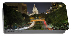 Portable Battery Charger featuring the photograph Austin Light Trails by Tim Stanley