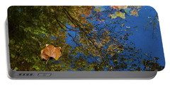 Portable Battery Charger featuring the photograph Autumn Leaf Reflections by Lon Dittrick