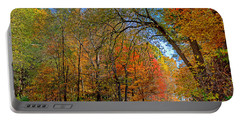 Portable Battery Charger featuring the photograph Autumn Light by Rodney Campbell