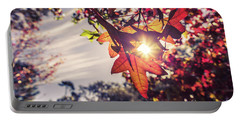 Portable Battery Charger featuring the photograph Autumn Sky And Colorful Leaves In Fall Season With Sun Shine On  by Jingjits Photography