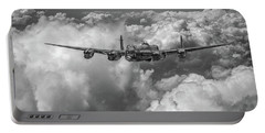 Portable Battery Charger featuring the photograph Avro Lancaster Above Clouds Bw Version by Gary Eason