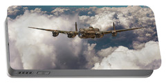 Portable Battery Charger featuring the photograph Avro Lancaster Above Clouds by Gary Eason