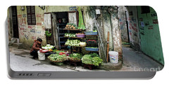 Back Street Veggies Store I Portable Battery Charger by Chuck Kuhn