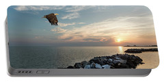 Bald Eagle Flying Over A Jetty At Sunset Portable Battery Charger