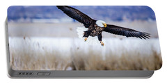 Portable Battery Charger featuring the photograph Bald Eagle Landing by Bryan Carter