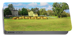 Baled Hay In A Grassy Field Portable Battery Charger