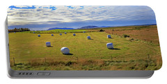 Bales Of Hay For The Animals Near Reykjavik, Iceland Portable Battery Charger by Allan Levin