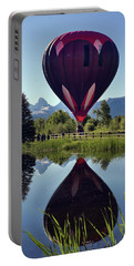 Balloon Reflection Portable Battery Charger by Leland D Howard