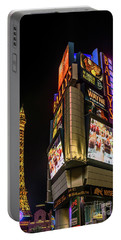 Portable Battery Charger featuring the photograph Ballys Sign In Front Of The Eiffel Tower At Night by Aloha Art