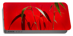 Bamboo Against Red Wall Portable Battery Charger