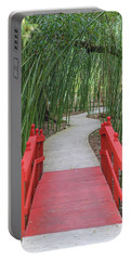 Portable Battery Charger featuring the photograph Bamboo Path Through A Red Bridge by Raphael Lopez