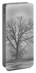 Bare Tree In Fog Portable Battery Charger by Nancy Landry