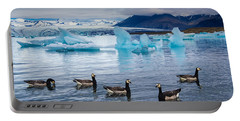 Portable Battery Charger featuring the photograph Barnacle Geese In Glacier Lagoon In Iceland by Matthias Hauser