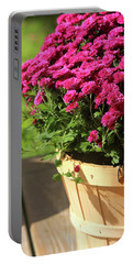 Portable Battery Charger featuring the photograph Basket Of Blooms by Trina Ansel