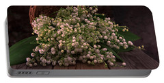Portable Battery Charger featuring the photograph Basket Of Fresh Lily Of The Valley Flowers by Jaroslaw Blaminsky
