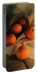 Portable Battery Charger featuring the photograph Basket Of Fresh Tangerines by Jaroslaw Blaminsky