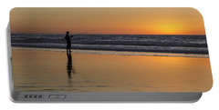 Beach Fishing At Sunset Portable Battery Charger by Ed Clark