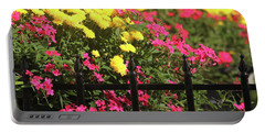 Portable Battery Charger featuring the photograph Beauty Beyond The Gate by Trina Ansel