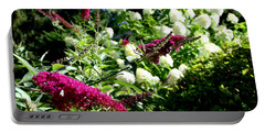 Portable Battery Charger featuring the photograph Beckoning Butterfly Bush by Hanne Lore Koehler