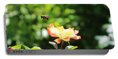 Bee Flying From Peach Petal Rose Portable Battery Charger