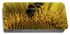 Portable Battery Charger featuring the photograph Bee In A Sunflower by Paul Freidlund