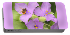 Portable Battery Charger featuring the photograph Bee On Purple Spiderwort by Sheila Brown