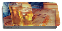 Portable Battery Charger featuring the photograph Beers In A Pub by Patricia Hofmeester