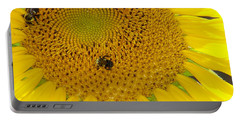 Portable Battery Charger featuring the photograph Bees Share A Sunflower by Sandi OReilly
