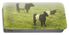 Belted Galloway Cows Grazing  In Foggy Farm Field Maine Portable Battery Charger