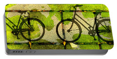 Portable Battery Charger featuring the mixed media Bicycle Parking by Nancy Merkle
