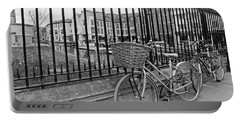 Portable Battery Charger featuring the photograph Bicycles On Magdalene Bridge Cambridge In Black And White by Gill Billington