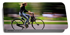 Portable Battery Charger featuring the photograph Bicycling Woman by Craig J Satterlee