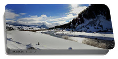 Big Sky Sunburst Over The Gallatin River Portable Battery Charger