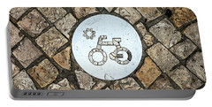 Bike Path Sign On A Cobblestone Pavement Portable Battery Charger
