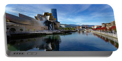 Bilbao In Autumn With Blue Skies Next To The River Nervion Portable Battery Charger