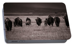 Portable Battery Charger featuring the photograph Bison Herd Into The Sunset - Bw by Chris Bordeleau