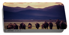 Bison Herd Into The Sunset Portable Battery Charger by Chris Bordeleau