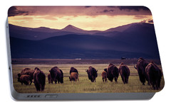 Portable Battery Charger featuring the photograph Bison Herd Into The Sunset by Chris Bordeleau