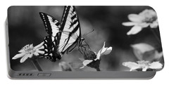 Black And White Butterfly On Flower Portable Battery Charger by Jim And Emily Bush