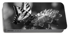 Black And White Butterfly On Zinnia Portable Battery Charger by Jim And Emily Bush