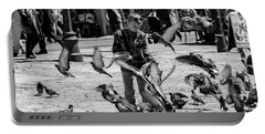 Black And White Of Boy Feeding Pigeons In Sarajevo, Bosnia And Herzegovina  Portable Battery Charger