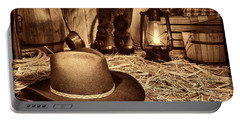 Black Cowboy Hat In An Old Barn Portable Battery Charger