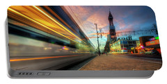 Portable Battery Charger featuring the photograph Blackpool Tram Light Trail by Yhun Suarez