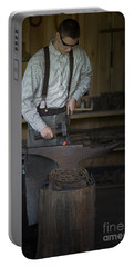 Portable Battery Charger featuring the photograph Blacksmith At Work by Liane Wright