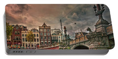 Portable Battery Charger featuring the photograph Blauwbrug -blue Bridge- by Hanny Heim