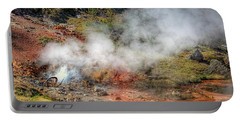 Blood Geyser Portable Battery Charger by Greg Sigrist