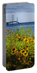 Blooming Flowers By The Bridge At The Straits Of Mackinac Portable Battery Charger by Randall Nyhof